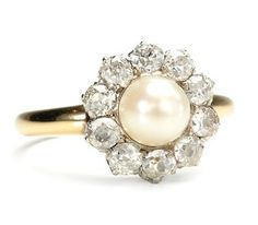 I'd like a pearl engagement ring, but I hear they get damaged easily! Pretty, nonetheless!