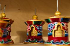 Colorful wooden paryer wheels with mantra to spread blessings in the surroundings. In Lotus Design winel
