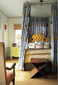 warm, rich colors. love the headboard and patterned canopy.