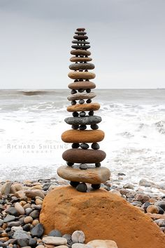 """Richard Shilling makes his """"land art"""" using only natural materials gathered near where the sculpture is made. Some of his work lasts only a few minutes before a change sweeps them away. Gallery of his work on the Telegraph site Land Art, Stone Balancing, Robin Hoods Bay, Rock Sculpture, Wow Art, Stone Crafts, Environmental Art, Art Plastique, Pebble Art"""