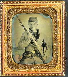 Unidentified soldier in Confederate infantry uniform with musket and brass framed revolver