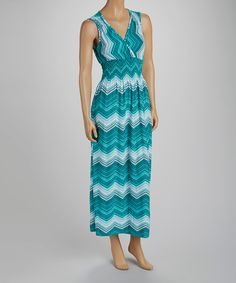 Look+fun+and+flirty+in+a+vibrant+maxi.+This+sleeveless+piece+boasts+a+flowing+silhouette+and+rich+colors+that+highlight+a+woman's+natural+beauty,+while+the+elasticized+smocked+waist+gently+hugs+the+body+for+a+comfortable+fit!