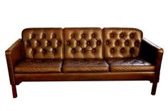 Vintage danish modern tufted leather sofa from Folding Chairs.