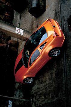 An orange car Orange Cars, Cars And Motorcycles, Vehicles, Car, Vehicle, Tools