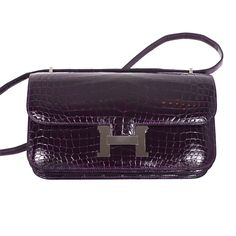 Stunning Bag Hermes Constance Elan Crocodile Amethyst Palladium | From a collection of rare vintage handbags and purses at http://www.1stdibs.com/fashion/accessories/handbags-purses/