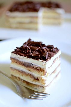 Heavenly Eggless Tiramisu -  Ingredients:  2 cups (500 gm) mascarpone cheese 1 cup heavy cream (or 1 1/4 cups to stretch the mascarpone mixture) 1/2 cup (about 100 gm) semi-sweet dark chocolate 1 cup strong espresso 3 to 4 T coffee liqueur such as Tia Maria or Kahlua 30 sponge fingers (or a 10″ sponge cake) 1/4 cup caster sugar 1/4 cup dark rum (or Marsala) Garnish: chocolate shavings or powder