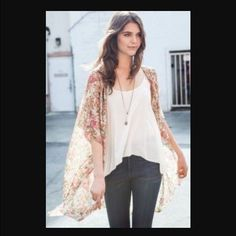 Brandy Melville Alexis Kimono in Cream Floral Like new; worn only once. % authentic Brandy Melville Alexis floral print kimono in a gorgeous cream color. Sheer, light and airy makes this an amazing layering piece.  Brandy Melville Tops