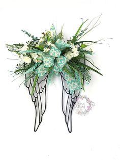 Angel Wings Decor Wrought Iron Angel Wings with aq… Mesh Wreaths, Holiday Wreaths, Floral Wreaths, Holiday Ideas, Angel Wings Decor, Beaded Ornament Covers, Grave Decorations, Memorial Flowers, Cemetery Flowers
