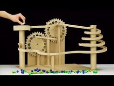 DIY Endless Marble Machine with Twisted Race Track In today's video I show you how to make endless marble race track machine from cardboard. Wooden Marble Run, Marble Toys, Marble Maze, Cardboard Sculpture, Cardboard Toys, Marble Tracks, Wooden Gear Clock, Marble Machine, Reuse Plastic Bottles