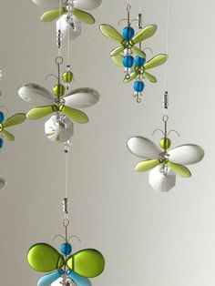 Does your nursery or childs room require a special something ...?  This charming green and blue firefly chandelier mobile has a great sparkle in sunlight and is a great accessory for any room. Place near a window or hang in the middle of the room. This mobile is bound to delight people of all ages. This firefly mobile has been hand crafted from Swarovski crystal and glass. Each firefly has its own character. They are one of a kind, as they are individually created by hand, making each…