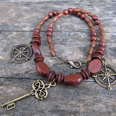 Casual & funky, this wooden beaded necklace spotlights a gorgeous antique bronze skeleton key and two compasses along with a matching lobster clasp. Rich brown wooden beads of various shapes and sizes are the perfect complement to these fantastic charms. Skeleton Keys, Wooden Beads, Finding Yourself, Beaded Necklace, Jewelry Making, Bronze, Charmed, Antiques, Bracelets