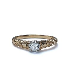Circa 1940 diamond Engagement ring. An Old European Cut diamond is set in a platinum crown between tapered shoulders embellished with a gorgeous engraved floral motif. The Ring is stamped with the Maker's mark of Jabel of Newark, NJ. A vintage original. 14K yellow gold and Platinum. Size 7.