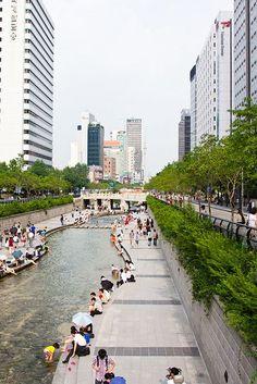 Cheonggyecheon Stream in Gwanghwamun Plaza, Seoul, South Korea. Places Around The World, Oh The Places You'll Go, Travel Around The World, Places To Travel, Places To Visit, Around The Worlds, South Korea Seoul, South Korea Travel, Urban Landscape