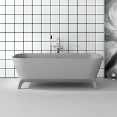 Lofty Grey is our signature tub and part of the Galfia collection. Its exquisite grey design has caught the public imagination to such a degree that it was nominated for a prestigious Archiproducts Design Award in 2019, the year of its entry into the market. The matt solid surface is creamy to the touch and the perfect material for a bathtub, encouraging maximum relaxation. Oak Vanity Unit, Freestanding Vanity Unit, Corian Colors, Deep Bathtub, Round Building, Claw Foot Bath, Solid Surface, Bathroom Furniture, Solid Oak