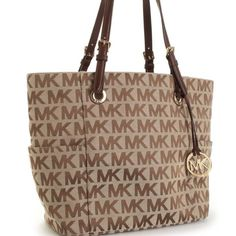 """❤️Authentic Michael Kors Jet Set Tote❤️ ❤️Whether starting your work day or kicking off a vacation, this signature Jet Set tote by MICHAEL Michael Kors will hold your essentials elegantly. A logo-embellished fabric exterior offers two side pockets, while the roomy interior of this tote boasts a zippered center section and plenty of pockets. Adjustable shoulder straps Exterior side pocket  One zippered interior pocket, three slide pockets  Approximate measurements: 16"""" W x 11"""" H x 5 1/2"""" D…"""