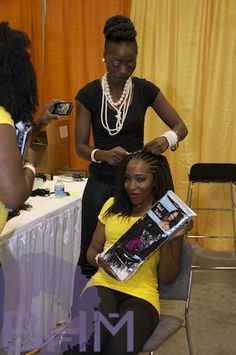 Love her hair! Attendee gets her hair styled at the World Natural Hair Show.
