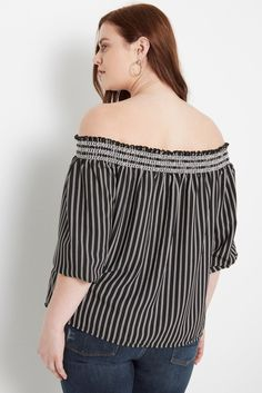 Details A striped fabric meets an off the shoulder neckline. Finished with 3/4 length sleeves. Unlined. Content & Care • 100%Polyester • Hand Wash Cold • Made in USA of Imported Fabric Size & Fit • Mo
