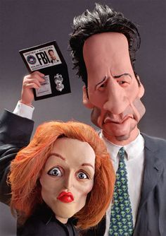 Mulder and Scully, X-Files FOLLOW THIS BOARD FOR GREAT CARICATURES OR ANY OF OUR OTHER CARICATURE BOARDS. WE HAVE A FEW SEPERATED BY THINGS LIKE ACTORS, MUSICIANS, POLITICS. SPORTS AND MORE...CHECK 'EM OUT!!