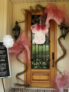 Cute door decorations for a baby girl shower, maybe a little overkill, but I love the giant bows.  :)