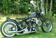 This is a wonderful example of a bobber. The black paint, the ape hanger handlebars, springer front end, and the white wall rear tire.