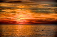 Sunset over the Alboran Sea, Motril, Spain taken by Jiuguang Wang.