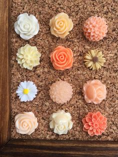 These fun and colorful pushpins cant help but bring your bulletin board some cheerfulness! They are handmade by carefully securing each flower design onto a standard size thumbtack.  This listing includes an assortment of twelve gorgeous flower pins as shown.  ~Color: A variety of shades including ivory, light pink, peach and white ~Amount: 12 ~Size: Flowers range from 13mm-16mm  These would make wonderful gifts for the special teacher in your life, a unique housewarming gift, or just to…