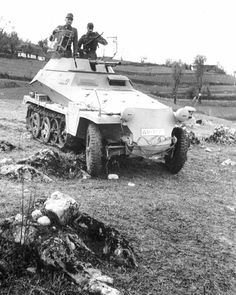 A SdKfz 250/9 Leichter light armored reconnaissance variant with open turret from the SdKfz 222 featuring a coaxial MG34 or 42 machine gun along with a 20mm KwK 38 auto cannon