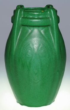 Weller Matt Green 9 5/8 inch vase with four buttresses and molded peacock feather design, covered with a good mat green glaze. Unmarked.