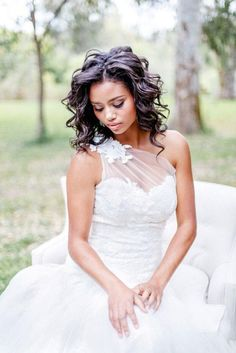 Featured photo: Brian LaBrada Photography via Bridal Musings. We love the one shoulder floral detail of this wedding dress.