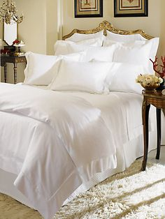 Each room and suite on our property proudly features the luxurious Sferra bedding collection.