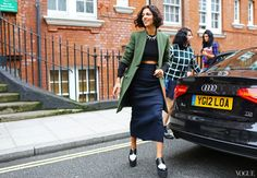 Fitted olive green coat, navy pencil skirt, and great two toned flat forms spotted on the streets of London.