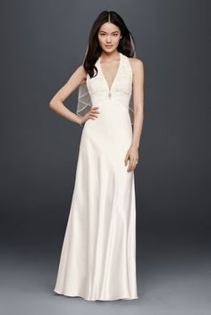 You'll look and feel incredible all day in this lightweight charmeuse sheath wedding dress. The chic halter style features a lace bodice, plunging V-neckline, and crystal embellishment at the ruched empire waistline.  DB Studio, Exclusively at David's Bridal  Charmeuse; Polyester  Zipper Back; Fully Lined  Dry Clean  Imported