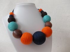 Colourful orange-blue- textile necklace,chunky fiber necklace with wooden bead,silk thread necklace, unique textile ball necklace https://www.etsy.com/listing/590754306/colourful-orange-blue-textile?ref=listing-shop-header-0