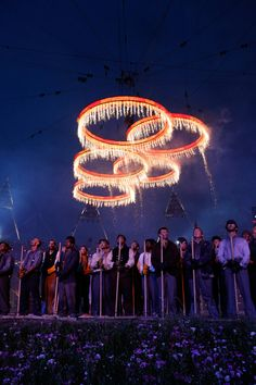 Olympic ring halos.  Pyrotechnics light up the Olympic rings, creating halos of light over the opening ceremony.