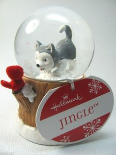 """Hallmark Jingle Pup & Cardinal Christmas Snowglobe by Hallmark. $29.38. Jingle Pup & Cardinal. Stands approximately 3 1/2"""" Tall. Made By Hallmark. 2011 Hallmark Jingle the Husky Pup Water Snow Globe. The Snow Globe is about 3 1/2 inches.The snow globe """"snows"""" when you pick it up and shake it."""