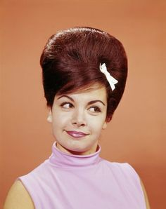 Annette Funicello accessorises her beehive with a cute bow