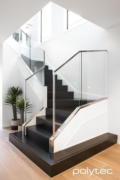 Stylish modern stairs in Black Valchromat finished with a clear coat Stairs Design Modern Black clear coat finished Modern Stairs Stylish Valchromat Home Stairs Design, Stair Railing Design, Interior Stairs, Modern House Design, Home Interior Design, Railing Ideas, Modern Railing, Staircase Design Modern, Contemporary Stairs
