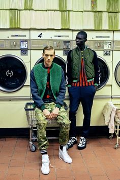 Men's Wear Trend: The Bomber Effect Photo by Kristiina Wilson From left: Sacai's wool jacket, Christopher Kane's cotton sweatshirt and Mark McNairy New Amsterdam's cotton pants. Common Projects sneakers; Jonathan Saunders' nylon jacket and cotton T-shirt and Public School's wool pants. Andrea Pompilio shoes.