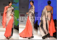 Model walks in beautiful black,grey and peach designer tricolor half and half saree with black plain border. Paired with grey designer spaghetti strap saree blouse for back with round collar neck pattern. Designed by Satya Paul at Day 1 WIFW Autumn/Winter 2013.
