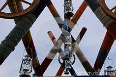 Photo about Wooden beams wrapped with colored string and retro lanterns attached. Image of crafts, crafted, wooden - 78161777 Photo Colour, Color, Beams, Lanterns, Stock Photos, Abstract, Retro, Image, Crafts