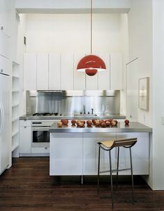 Above: A red Verner Panton Flowerpot lamp in a NYC kitchen by Messana O'Rorke Architects.