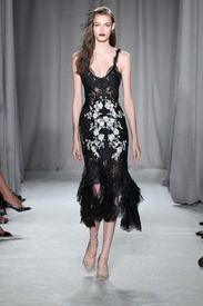 A model walks the runway at the Marchesa show during Spring 2014 Mercedes-Benz Fashion Week at New York Public Library on September 11, 2013 in New York City. New York Fashion Week Spring/Summer 2014: Day Eight - via MyDaily