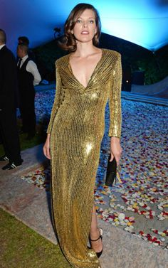 Milla Jovovich in a gleaming Saint Laurent gown
