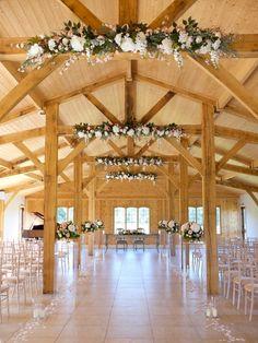 wedding flowers merrydale manor - beam flower garlands - ceremony flowers - aisle arrangements on pinths - Laurel Weddings - Cheshire florist