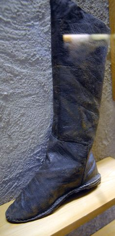 Novgorod tall boot. I think some punchholes from embroidery are visible to the top, but the glare from the glass makes me uncertain.