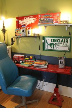 Desk made from truck gate and jacks  Desk chair from car bucket seat  Shelves created from truck sideboards and vintage signs  Wall art created using flower pots and fan blades  Curtain valance and floor runner made from tire tread. Floor lamp and table lamp made using salvaged auto parts Plastic oil containers transformed into pencil holders