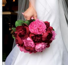 Jennifer's pink and burgundy peonies held special meanings around their stems. A clear rhinestone A (for Mathew's last name, Alexander) was pinned on the pink ribbon, and her cousin's red rosary -- a gift from the girls' grandmother -- was wrapped around ...