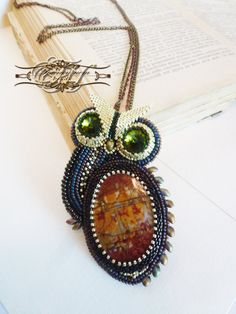 """beaded pendant and brooch """"Owl"""" with natural jasper cabochon and green Swarovski pastes"""