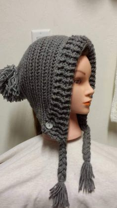 Check out this item in my Etsy shop https://www.etsy.com/listing/515781499/earflap-slouchy-hat-with-braids-and-pom