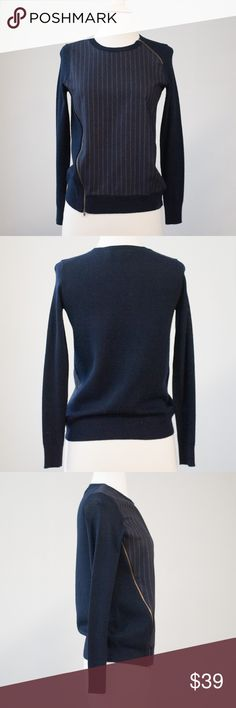 J. Crew Pinstripe Zip Sweater Assymetrical zip sweater in navy blue with red and white pin stripes. Zipper on the side as well as the left shoulder. Long sleeves. Crew neck. 98% wool, 2% elastane. XXS. Works well for size 0-4. Dry clean. J. Crew Sweaters Crew & Scoop Necks